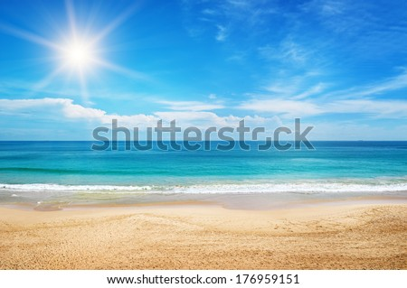 seascape and sun on blue sky background - stock photo