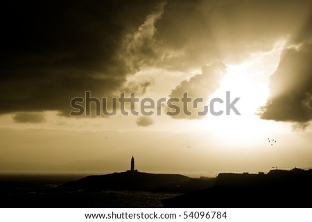 seascape at dawn. Hercules tower, galician lighhouse - stock photo