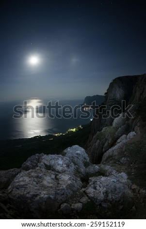 Seascape at night. The coastline moonlight and stars in the sky - stock photo