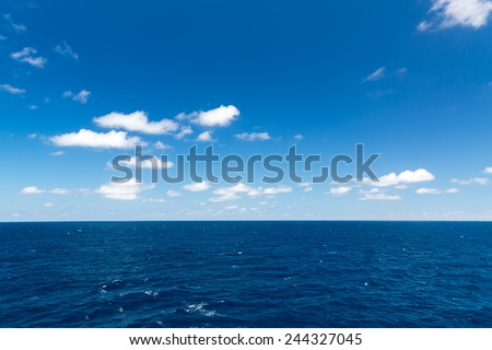 Seascape. Blue sky and white cloud. Calm sea. - stock photo
