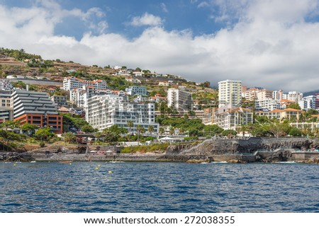 Seascape coastline Madeira Island with several modern Hotels of Funchal - stock photo