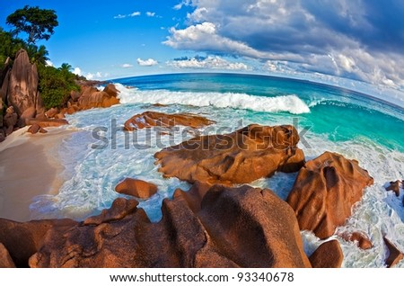 Seascape  fisheye view  with a huge stones, Seychelles, LaDigue island, The Indian Ocean - stock photo