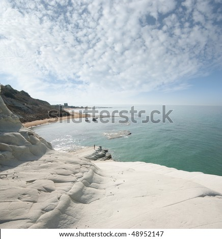 seascape of bay with white cliff and overcast sky - stock photo