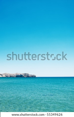 seascape of rocks under blue sky