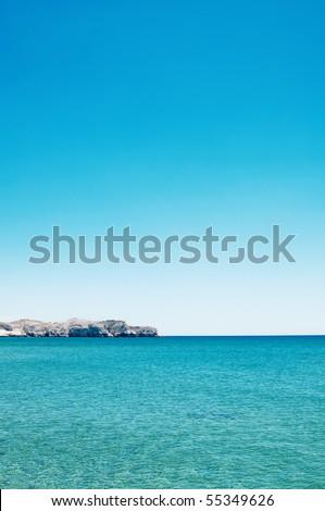 seascape of rocks under blue sky - stock photo