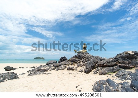 Seascape of sky and beach which has mermaid statue on rock ; Songkhla Thailand