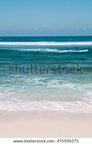 Seascape of tropical white sand beach with turquoise blue water suitable for background, vertical option for wallpaper