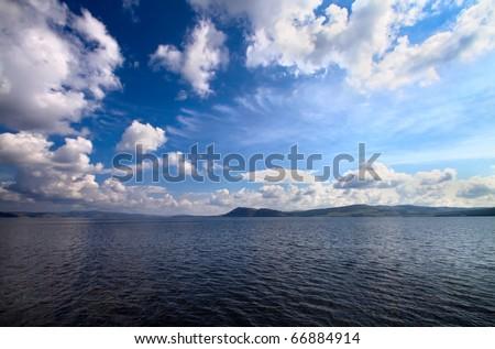 seascape. seacoast and fantastic blue cloudy sky - stock photo