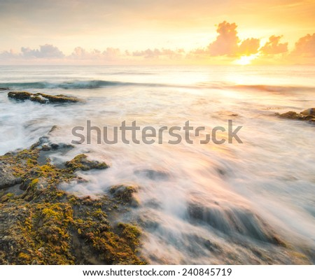 Seascape Sunrise Waves Flow Hit the Rock During  - stock photo