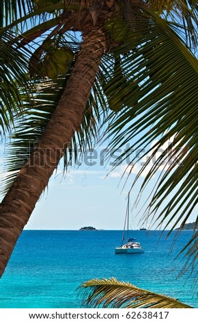 Seascape view with a nice  yacht, Seychelles, La Digue island - stock photo