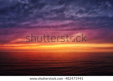 seascape with a red sunset