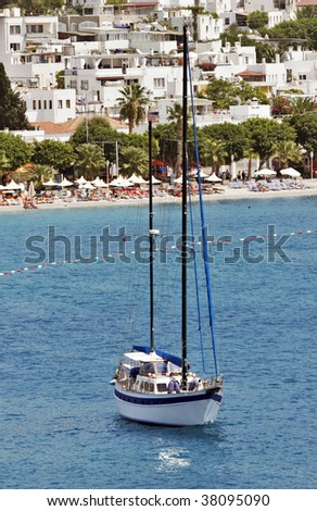 seascape with anchored sailboat off the beach, Bodrum, Turkey - stock photo