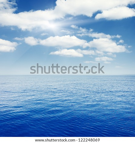 Seascape with beautiful clouds and turquoise ocean - stock photo