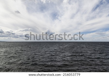 seascape with big clouds - stock photo