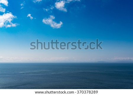 Seascape with blue sky and clouds.
