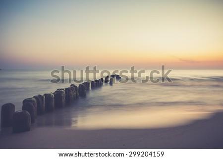 Seascape with breakwaters. vintege landscape polish sea shore - stock photo