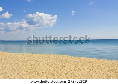 Seascape with calm blue sea, little clouds and sandy beach, recorded in Saint Constantine and Saint Helen resort, Bulgaria. - stock photo