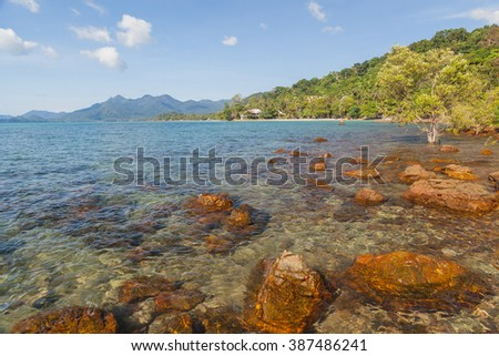 Seascape with coast on blue sky background - stock photo