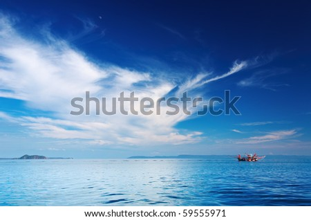 Seascape with fishing boat, Thailand - stock photo