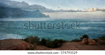 Seascape with mountain in morning light