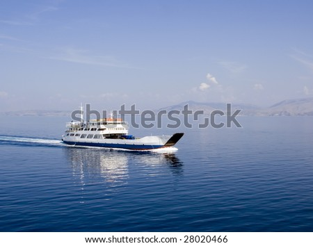 Seascape with moving passenger ferry