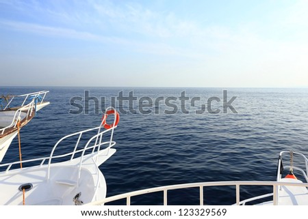 Seascape with red lifebuoy ring - stock photo