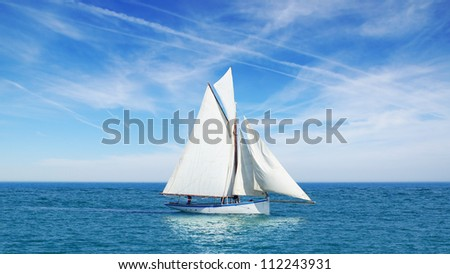 Seascape with sailboat the background of the blue sky. - stock photo