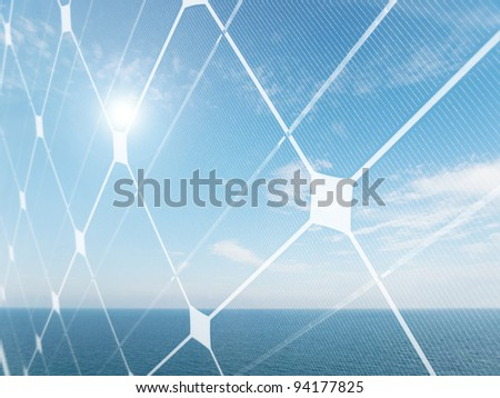 Seascape with shining sun and photovoltaic panel - stock photo