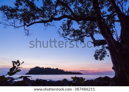 Seascape with small island at dusk twilight background - stock photo
