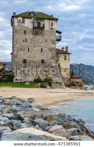 Seascape with Stones Medieval tower in  Ouranopoli, Athos, Chalkidiki, Central Macedonia, Greece