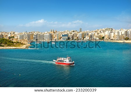 Seascape with touristic boat. Valletta. Malta - stock photo