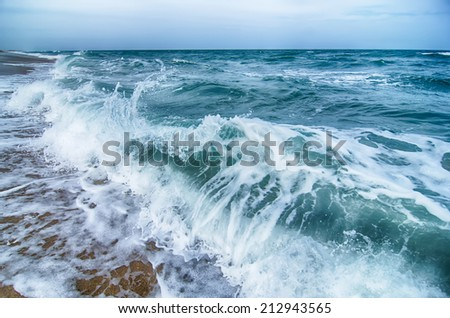seascape with waves and sand beach scenery - stock photo