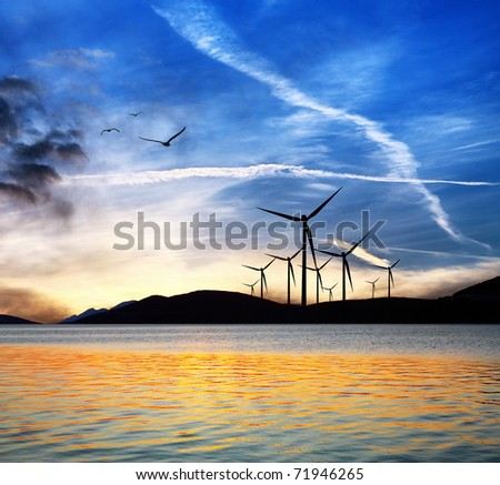 Seascape with wind turbines - stock photo