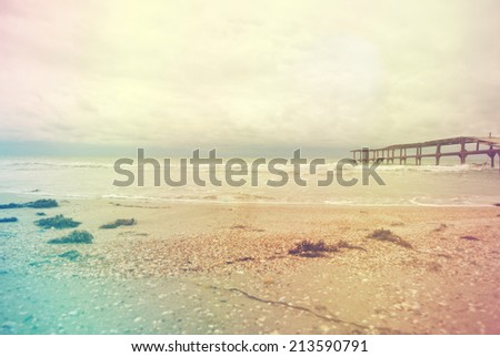 Seascape with wooden pier - stock photo