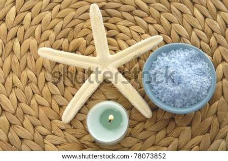 seashell  and bowl of salt on mat - stock photo