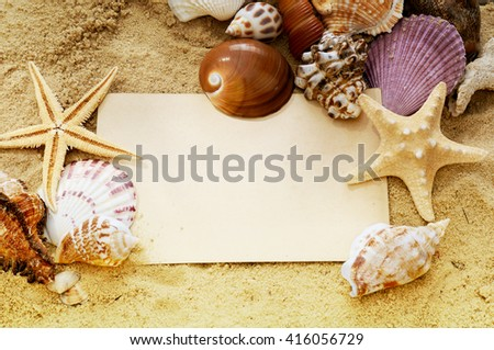 Seashell background with empty vintage postcard blank. Summer holiday concept