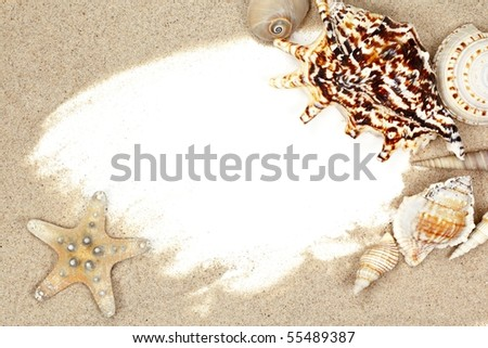 Seashell with sand beach frame - stock photo