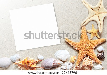 Seashells and starfish on the beach with paper blank