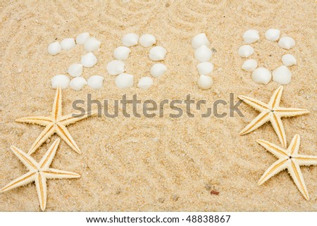 Seashells making a date in the sand, vacation 2010 - stock photo
