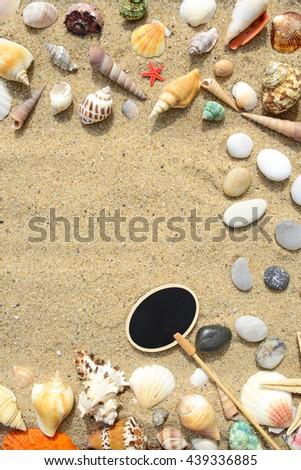 Seashells, sand and starfish background - stock photo