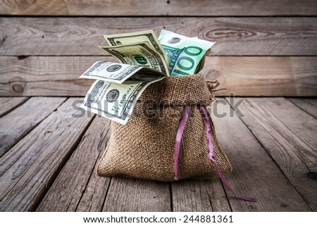 Seashells with money / holiday money - stock photo