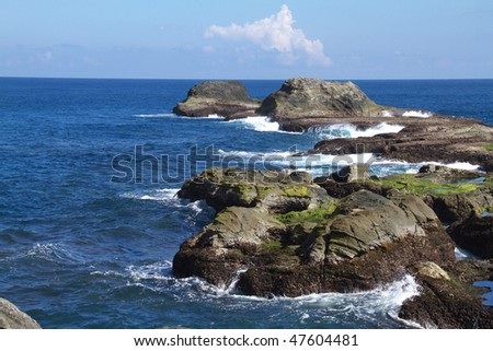 Seashore in Tai Wan on a sunny day with blue sky and sea. - stock photo