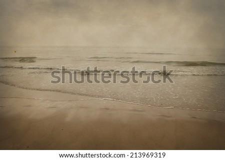 seashore in the north sea, textured background - stock photo