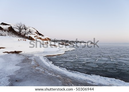 Seashore landscape in winter at sunset, Hanko, Finland. - stock photo