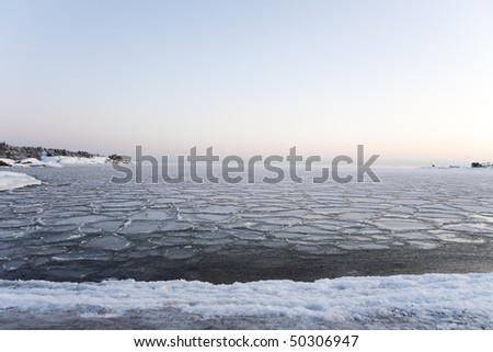 Seashore landscape in winter at sunset, Hanko, Finland.