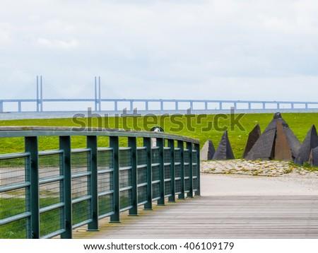 Seashore of the Oresund Strait with bridge between Denmark and Sweden. Oresund Bridge or Oresundsbron on background - stock photo