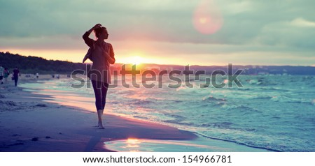 Seashore sunset walk - stock photo