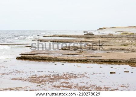 Seashore with limestone rocks - stock photo