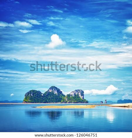 seashore with tall rocks, Andaman Sea, Thailand - stock photo