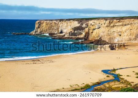 Seaside beach and cliff Santa Cruz.  Bonny Doon beach cliff. - stock photo